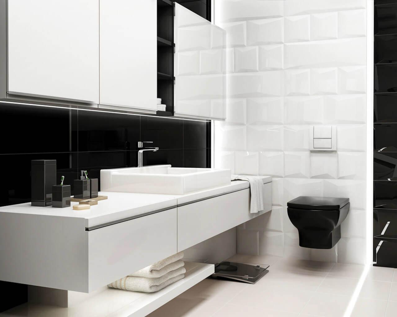 Biel, czerń i struktura w niedużej, minimalistycznej łazience