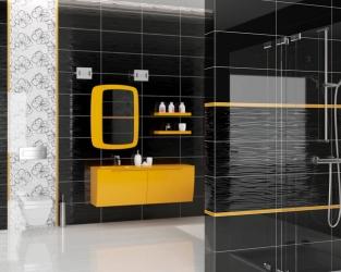 Czarno-biała łazienka z wanną i przeszkloną kabiną prysznicową