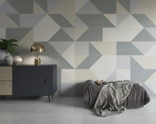 Salon w stonowanych beżach i szarościach, z geometryczną ścianą