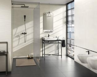 Biel i szarość w minimalistycznej, przestronnej łazience