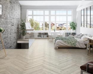 Świetlista sypialnia w stylu skandynawskim na poddaszu