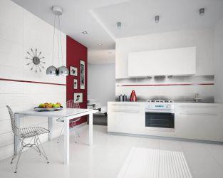 Minimalistyczna biała kuchnia z czerwonym akcentem