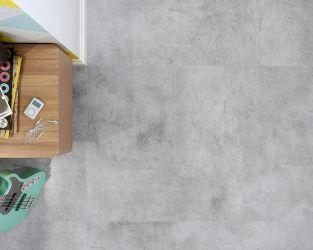 """Fragment nowoczesnego salonu z """"betonową"""" podłogą"""