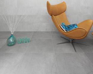 Szary, monochromatyczny salon w stylu minimalistycznym