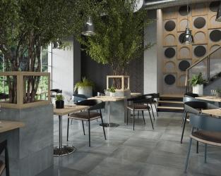 Przestronna nowoczesna restauracja w odcieniach naturalnego szarego kamienia