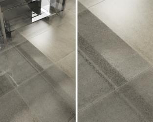 Szklane schody i szara podłoga w nowoczesnym wnętrzu