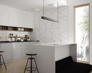 Biała kuchnia z wyspą i geometrycznym akcentem
