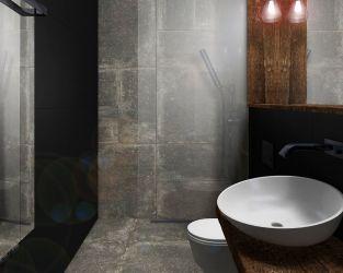 Szarość betonu i kamienia, czarne płytki i drewno w surowej łazience