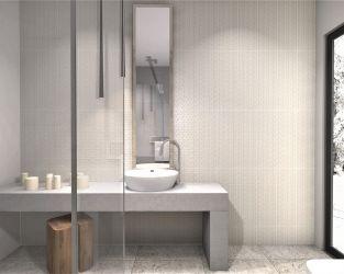 Monochromatyczne zabawy fakturą w jasnej łazience z wysokim oknem