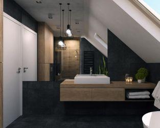 Drewno, ciemny kamień i szkło w łazience na poddaszu